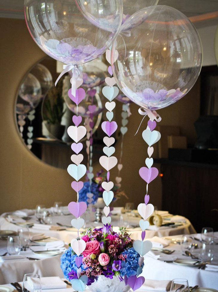 50 totally irresistible wedding balloon ideas brasslook 2 transparent balloon filled with flower petals or papers via pinterest junglespirit Choice Image