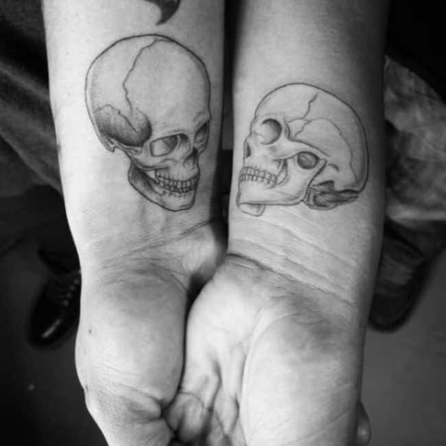 Matching Skull Tattoos.