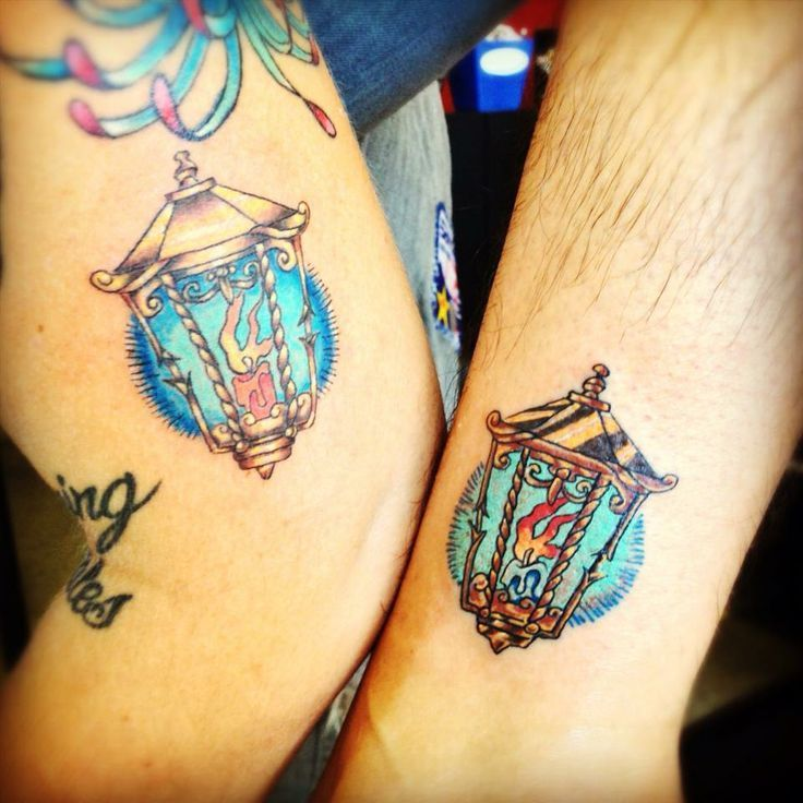 Matching colorful candle lamp tattoos.
