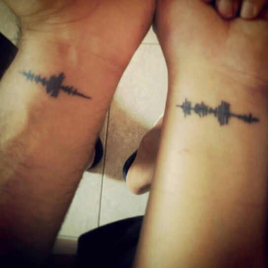 "Sound wave couples tattoo of ""I Love You"" spoken to each other."
