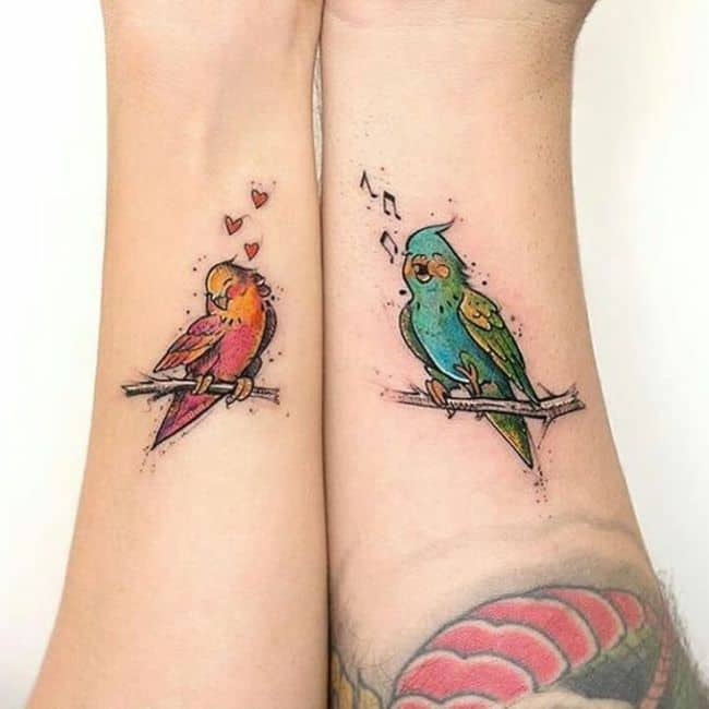 The love birds wrist tattoos.